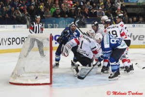 Minsk's Evgeny Kovyrshin, left, scores the 3-4 againt Team Canada's goalkeeper Drew Macintyre, right, during the game between HK Dinamo Minsk and Team Canada at the 90th Spengler Cup ice hockey tournament in Davos, Switzerland, Monday, December 26, 2016. (EQ Images/Melanie Duchene)